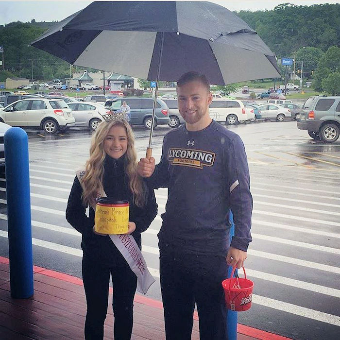 with help from her brother andrew collects money for childrenss miracle network hospitals at the lewistown walmart